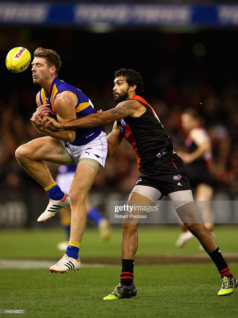 Beau Waters of the Eagles flies for a mark as Courtenay Dempsey of the Bombers spoils during the round seven AFL match between the Essendon Bombers and the West Coast Eagles at Etihad Stadium on May 12, 2012 in Melbourne, Australia.