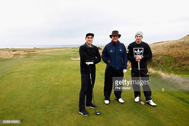 Beauden Barrett and TJ Perenara of the All Blacks pose as they play a round of golf with Scottish golfer Sandy Lyle at the Gullane Golf Club on...