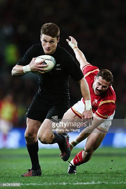 Beauden Barrett of New Zealand beats the tackle from Hallam Amos of Wales on his way to score a try during the International Test match between the...