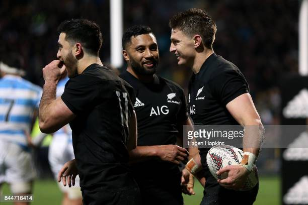 Beauden Barrett of New Zealand celebrates his try with teammates Lima Sopoaga and Nehe MilnerSkudder during The Rugby Championship match between the...