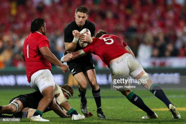 Beauden Barrett of New Zealand is tackled by Mako Vunipola and Alun Wyn Jones of the Lions during the International Test match between the New...
