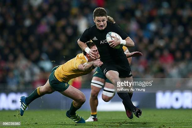 Beauden Barrett of New Zealand makes a break against Dane HaylettPetty of Australia during the Bledisloe Cup Rugby Championship match between the New...