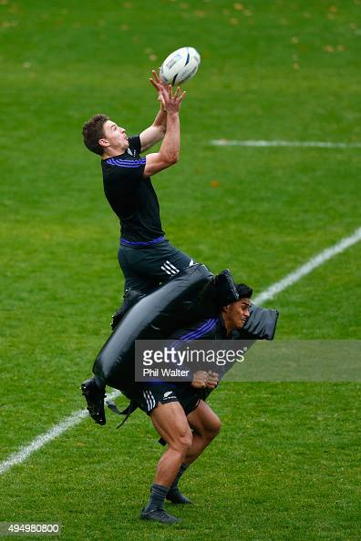 Beauden Barrett of the All Blacks collects the high ball over Malakai Fekitoa during a New Zealand All Blacks Captain's Run at Pennyhill Park on...