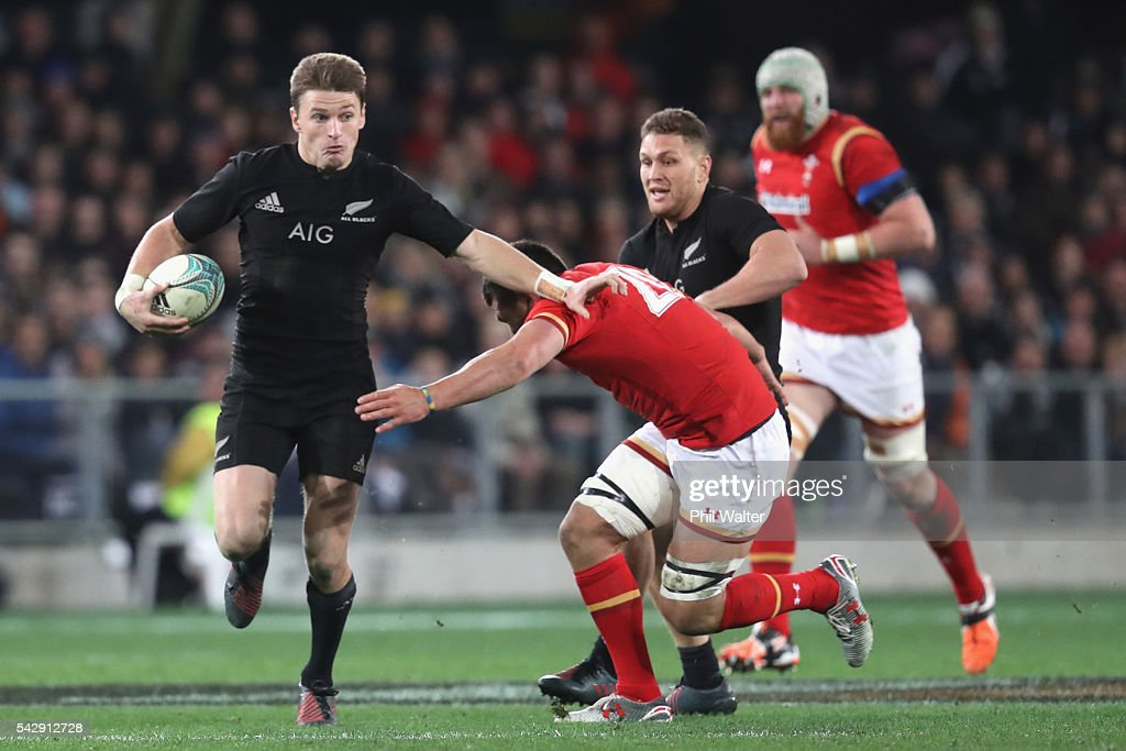 Beauden Barrett of the All Blacks fends off Luke Charteris of Wales during the International Test match between the New Zealand All Blacks and Wales at Forsyth Barr Stadium on June 25, 2016 in Dunedin, New Zealand.