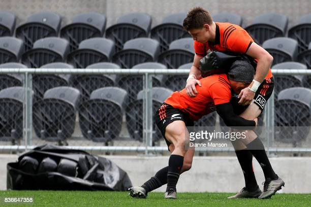 Beauden Barrett of the All Blacks is tackled by Aaron Smith during a New Zealand All Blacks Training Session on August 22 2017 in Dunedin New Zealand