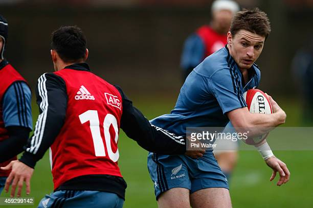Beauden Barrett of the All Blacks is tackled by Dan Carter during the New Zealand All Blacks training session at Sophia Gardens on November 20 2014...