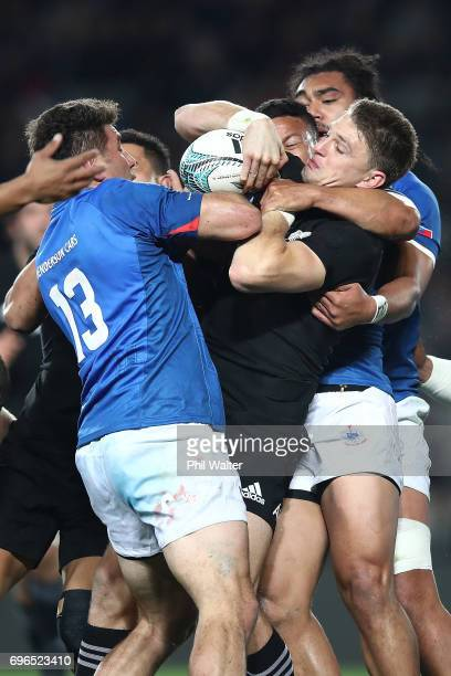 Beauden Barrett of the All Blacks is tackled during the International Test match between the New Zealand All Blacks and Samoa at Eden Park on June 16...