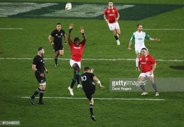 Beauden Barrett of the All Blacks kicks the ball upfield past Maro Itoje during the Test match between the New Zealand All Blacks and the British...