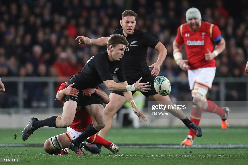 Beauden Barrett of the All Blacks passes in a tackle during the International Test match between the New Zealand All Blacks and Wales at Forsyth Barr Stadium on June 25, 2016 in Dunedin, New Zealand.