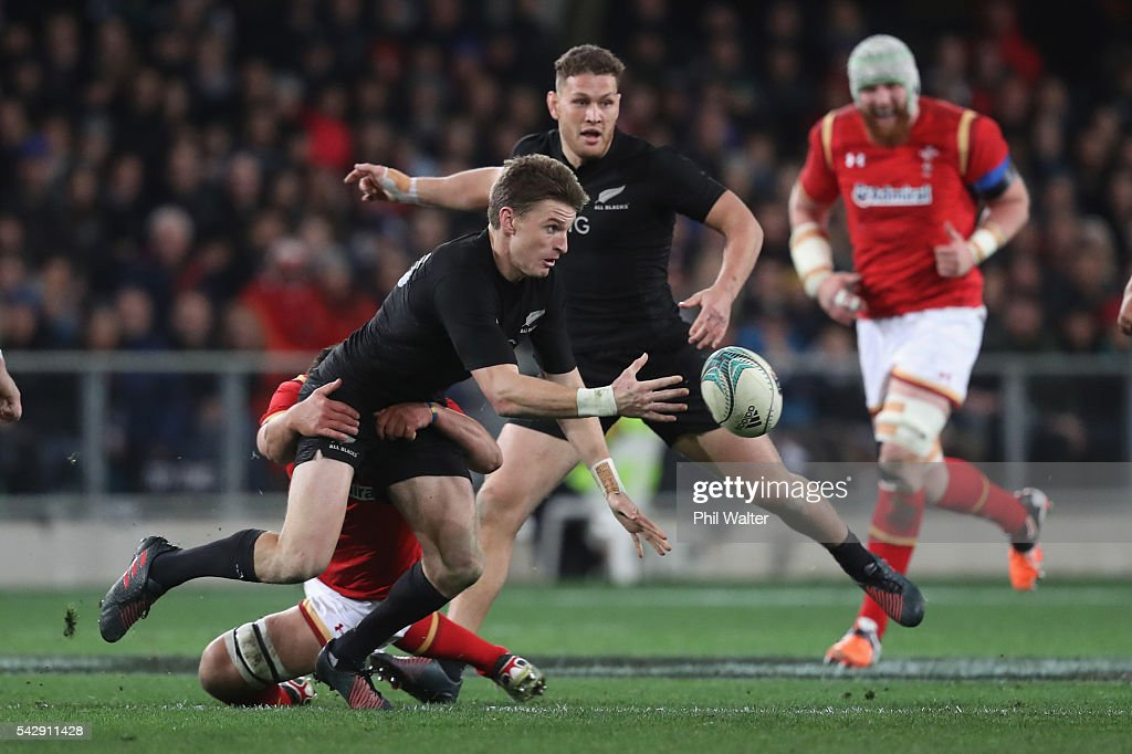 <a gi-track='captionPersonalityLinkClicked' href=/galleries/search?phrase=Beauden+Barrett&family=editorial&specificpeople=7264286 ng-click='$event.stopPropagation()'>Beauden Barrett</a> of the All Blacks passes in a tackle during the International Test match between the New Zealand All Blacks and Wales at Forsyth Barr Stadium on June 25, 2016 in Dunedin, New Zealand.