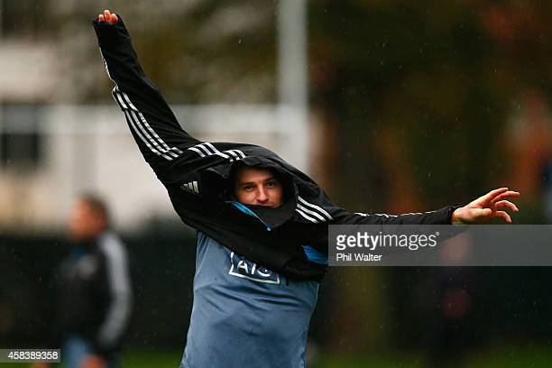 Beauden Barrett of the All Blacks puts on a jacket during a New Zealand All Blacks training session at Latymers on November 4 2014 in London England