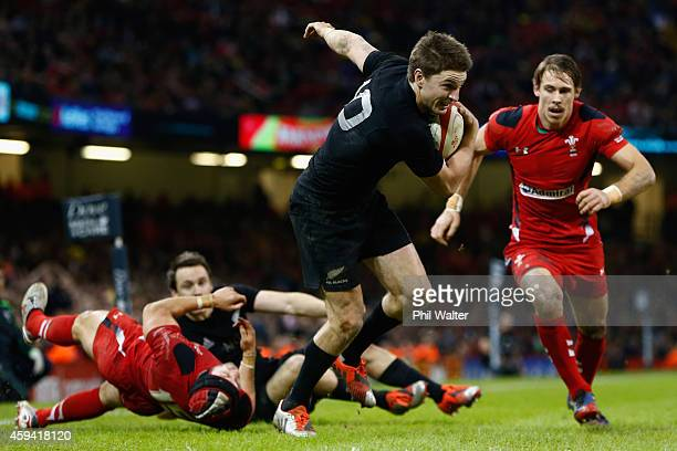 CARDIFF WALES NOVEMBER Beauden Barrett of the All Blacks runs into score a try during the Intenational match between Wales and the New Zealand All...