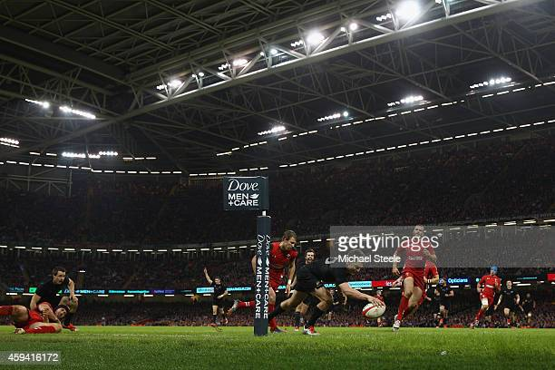 Beauden Barrett of the All Blacks scores his sides fourth try during the International match between Wales and New Zealand at the Millennium Stadium...