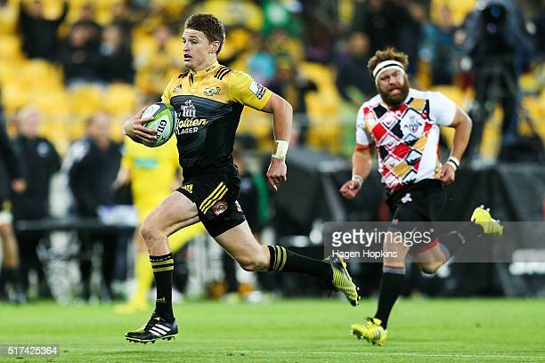 Beauden Barrett of the Hurricanes breaks away for a try during the round five Super Rugby match between the Hurricanes and the Kings at Westpac...