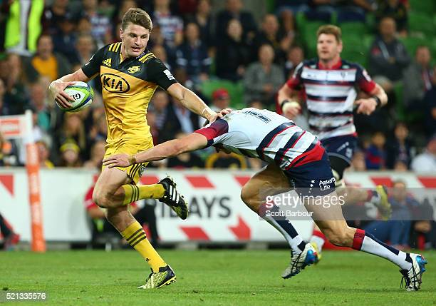 Beauden Barrett of the Hurricanes breaks away to score a try during the round eight Super Rugby match between the Rebels and the Hurricanes at AAMI...