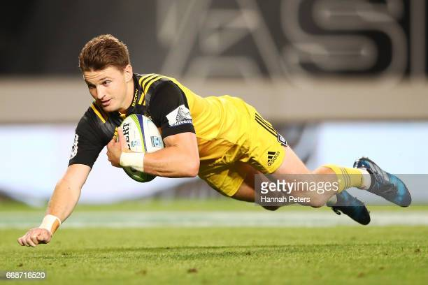 Beauden Barrett of the Hurricanes dives over fora try during the round eight Super Rugby match between the Blues and the Hurricanes at Eden Park on...