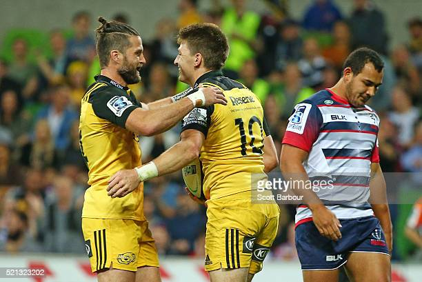 Beauden Barrett of the Hurricanes is congratulated by Cory Jane after scoring a try during the round eight Super Rugby match between the Rebels and...