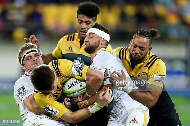 Beauden Barrett of the Hurricanes is tackled by Sam Cane and Aaron Cruden of the Chiefs during the round nine Super Rugby match between the...
