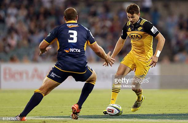 Beauden Barrett of the Hurricanes kicks ahead during the round one Super Rugby match between the Brumbies and the Hurricanes at GIO Stadium on...