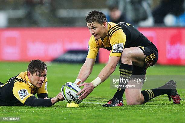 Beauden Barrett of the Hurricanes lines up a kick while teammate Jason Woodward holds the ball on the tee during the Super Rugby Quarterfinal match...