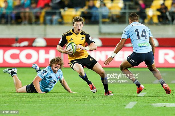Beauden Barrett of the Hurricanes looks to beat the challenge of Peter Betham of the Waratahs during the round 10 Super Rugby match between the...