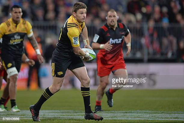 Beauden Barrett of the Hurricanes looks to pass the ball during the round 17 Super Rugby match between the Crusaders and the Hurricanes at AMI...