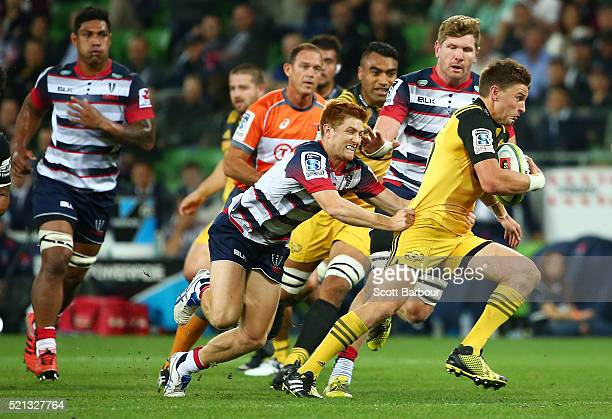 Beauden Barrett of the Hurricanes makes a break and scores a try during the round eight Super Rugby match between the Rebels and the Hurricanes at...