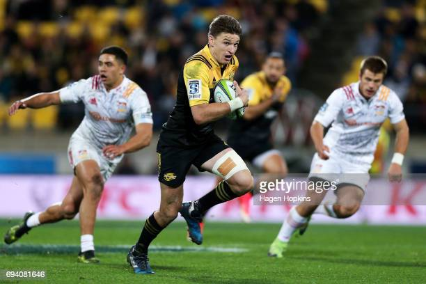 Beauden Barrett of the Hurricanes makes a break during the round 16 Super Rugby match between the Hurricanes and the Chiefs at Westpac Stadium on...