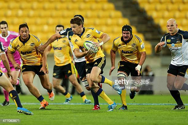 Beauden Barrett of the Hurricanes makes a break during the round four Super Rugby match between the Hurricanes and the Brumbies at Westpac Stadium on...