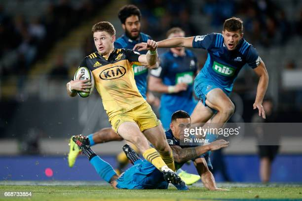 Beauden Barrett of the Hurricanes makes a break during the round eight Super Rugby match between the Blues and the Highlanders at Eden Park on April...