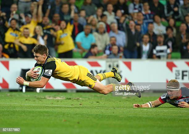 Beauden Barrett of the Hurricanes scores a try during the round eight Super Rugby match between the Rebels and the Hurricanes at AAMI Park on April...