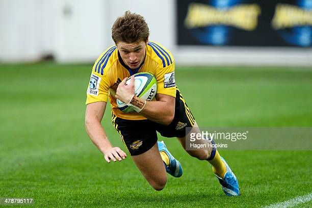 Beauden Barrett of the Hurricanes scores a try during the round five Super Rugby match between the Hurricanes and the Cheetahs at Westpac Stadium on...