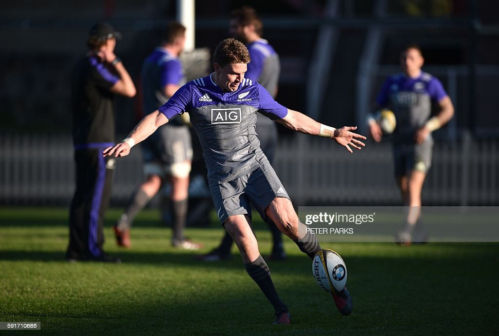 Beauden Barrett of the New Zealand All Blacks practises kicking during a rugby training session in Sydney on August 18 2016 Barrett has been rewarded...