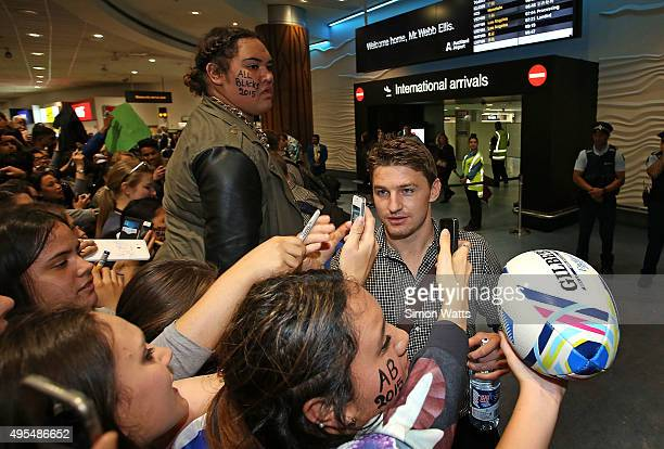 Beauden Barrett of the New Zealand All Blacks signs autographs after arriving at the Auckland International Airport on November 4 2015 in Auckland...