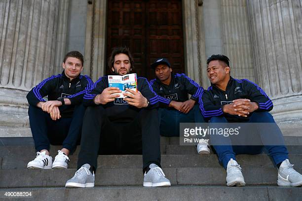 Beauden Barrett Samuel Whitelock Waisake Naholo and Samuel Whitelock of the All Blacks look over a London Timeout guide in front of St Pauls...