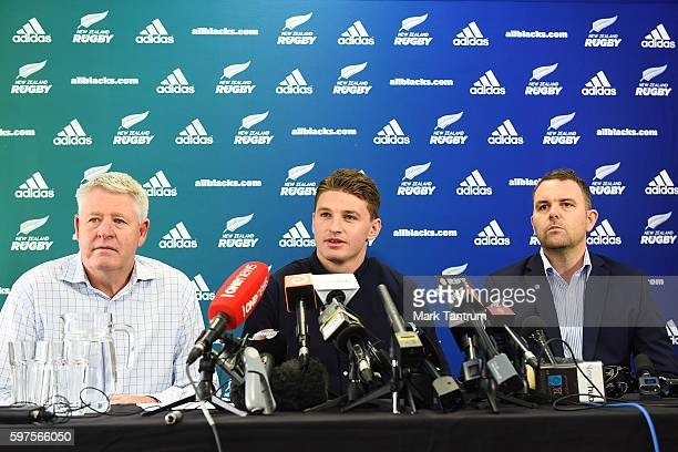 Beauden Barrett speaks to the media after resigning with the All Blacks and the Hurricanes To his left is New Zealand Rugby Chief Executive Steve Tew...