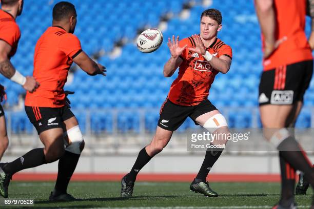 Beauden Barrett takes a catch from Ngani Laumape during a New Zealand All Blacks training session at Trusts Stadium on June 20 2017 in Auckland New...