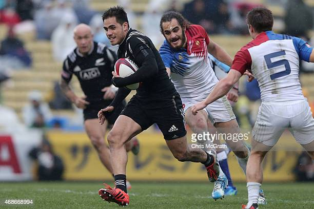 Beaudine Wakka of New Zealand makes a break against France during the Plate Semifinal match between New Zealand and France on day two of the Tokyo...