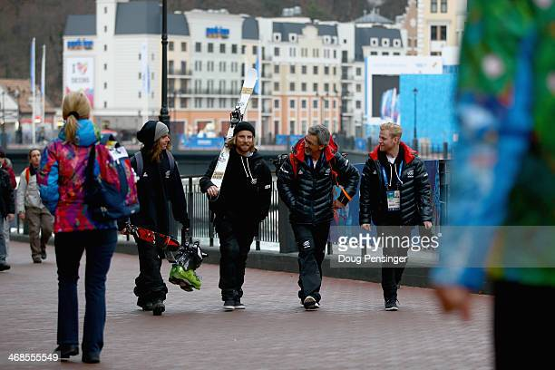 BeauJames Wells Jossi Wells father Bruce Wells and Byron Wells of Wanaka New Zealand walk through the Rosa Khutor ski village during the 2014 Winter...