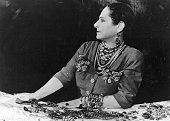 Beautician and business executive Helena Rubinstein modelling a selection of jewellery