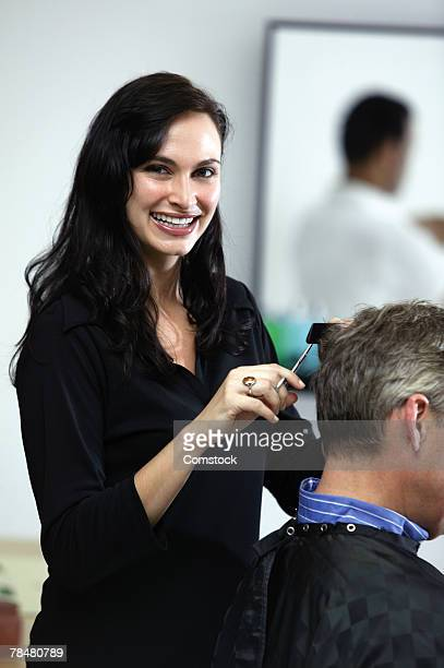 Beautician giving hair cut