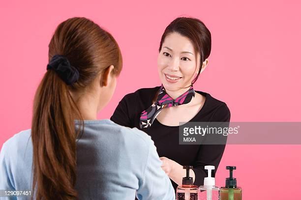 Beautician Talking to Customer