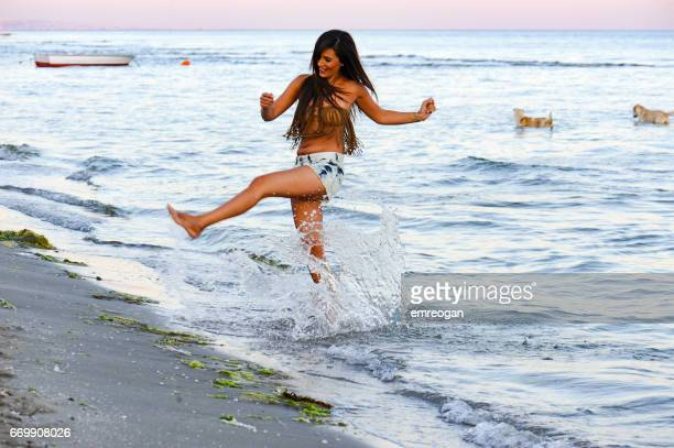 Beautifu woman running on the beach