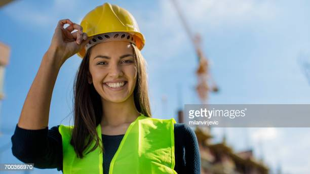 Beautifu young engineer at construction site