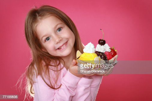 A Beautiful 5 12 Year Old Girl Holding A Banana Split