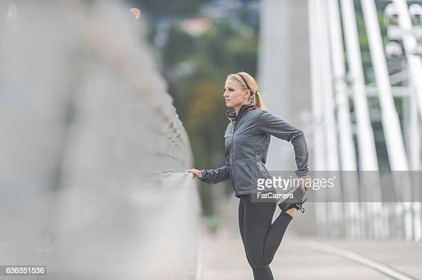 Beautiful adult female running out in the city