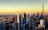 Colorful aerial skyline at sunset. Downtown Dubai with modern skyscrapers.  Fantastic travel background.