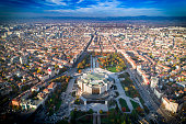 Amazing wide aerial drone shot of national palace of culture in Sofia city downtown in autumn.  The shot was taken near sunset with DJI Phantom 4 Pro drone / quadcopter.
