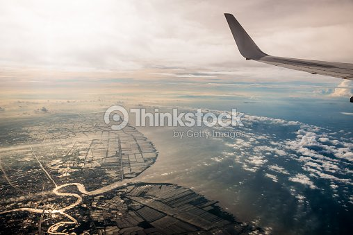 Beautiful Aerial View Of Bangkok Land And Sea From The Plane With Airplane Wing Stock