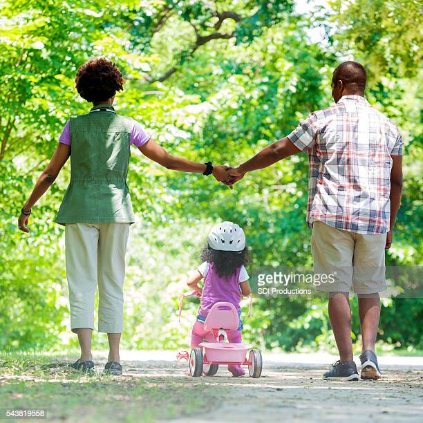 Beautiful African American family on a walk in the park